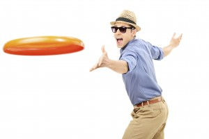 Young man throwing a frisbee disk