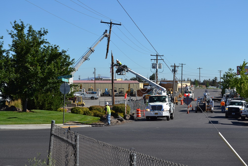 Crews work to repair services and a severed utility pole at Empire Avenue and Nels Anderson Road in Bend.