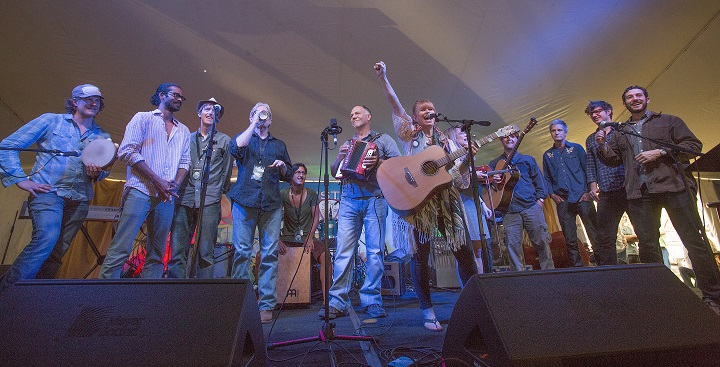 Sara Hickman leads the Community Celebration at the 2014 Sisters Folk Festival. Photo by Jay Mather.