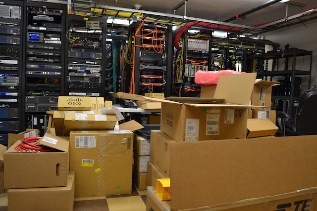 Boxes of new equipment have piled up in BendBroadband's control center, where crews are in the process of doubling network capacity.